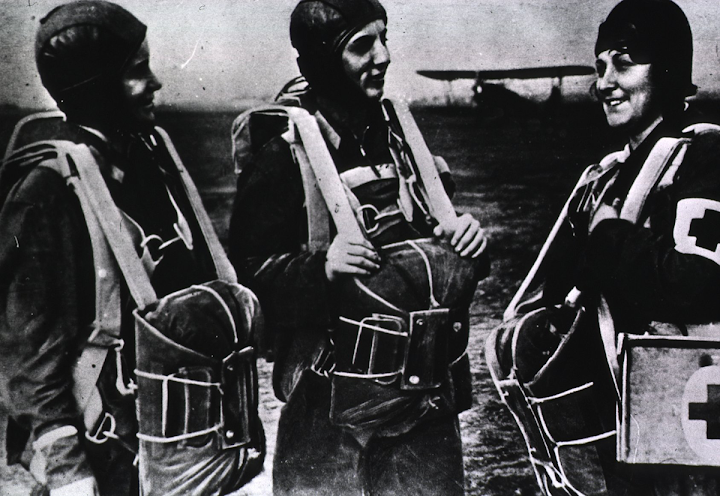 The first parachute nurses WHO/Red Cross photo.