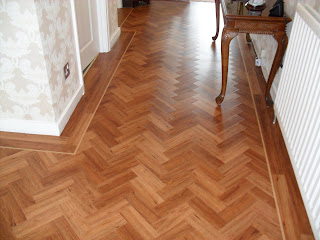 Amtico Flooring in Teak laid with a two plank border,a 10mm design ...