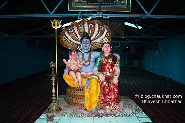 Statue of Shiv-Parvati and baby Ganesh at Neelkantheshwar temple atop a big mountain near Panshet and Varasgaon dams near Pune city
