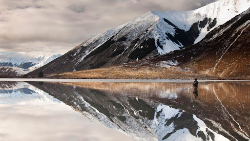 Fisherman Reflected, Lake Pearson, Canterbury, New Zealand.jpg