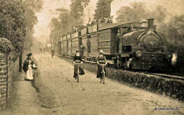 Train steam and Lady cyclists near West Cross also lady with basket