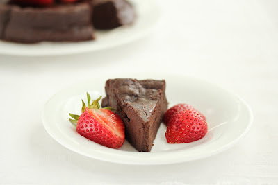 a slice of three ingredient chocolate cake on a plate