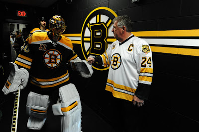 Terry O'Reilly greets Bruins players before the game