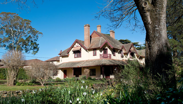 Kerever Park, Burradoo - Queen Anne Style, but owes some design ideas to the Gothic Revival for the 90 degree gables, and verandahs in Arts and Crafts style