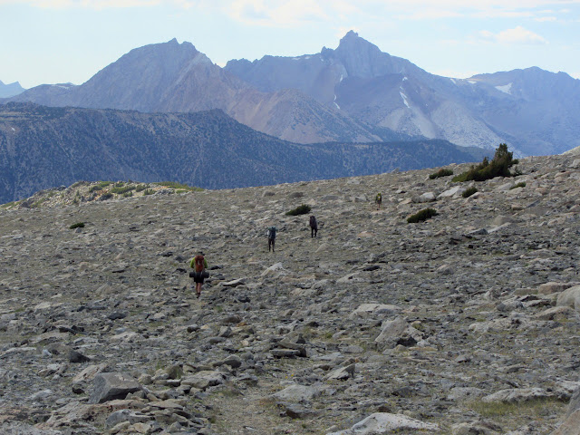 hikers on a rocky flat
