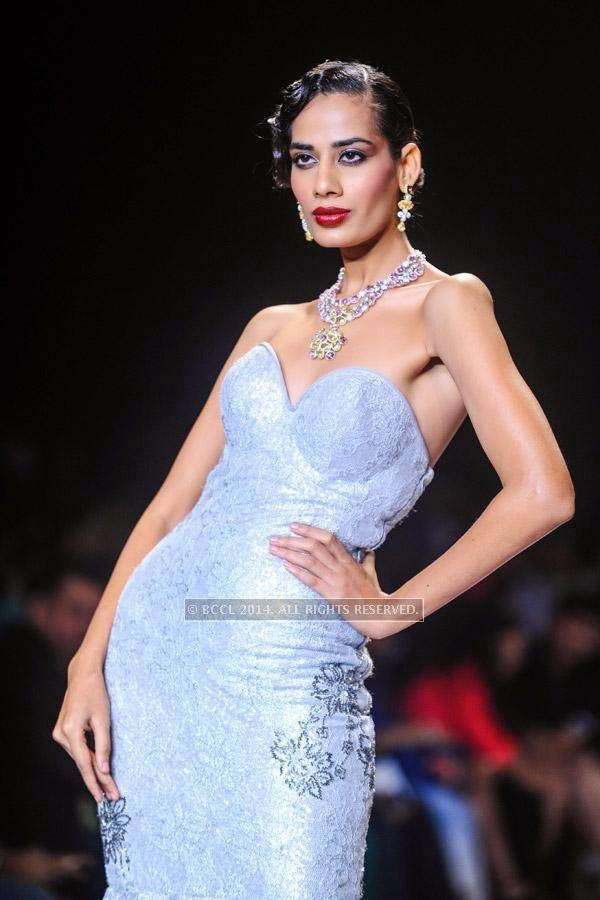 A model displays a creation for Gitanjali on Day 2 of India International Jewellery Week (IIJW), 2014, held at Grand Hyatt, in Mumbai.<br /> <br /> <br />