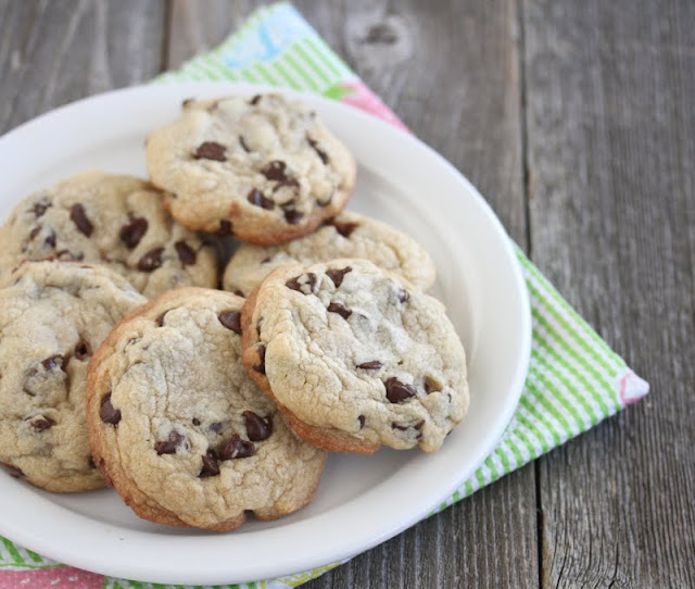 a photo of a plate of Truffle Stuffed Chocolate Chip Cookies