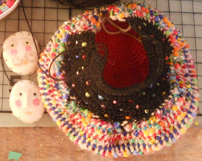 Top view of the bottom of the doll's body, made of a very tight knit and seed beads
