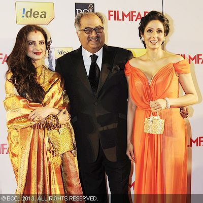 Rekha, Boney Kapoor and Sridevi pose for the cameras at the 58th Idea Filmfare Awards in Mumbai.Click here for:<br />  58th Idea Filmfare Awards