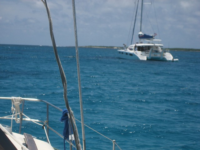 Catamaran anchored near buoys at Sandy Cay coral garden
