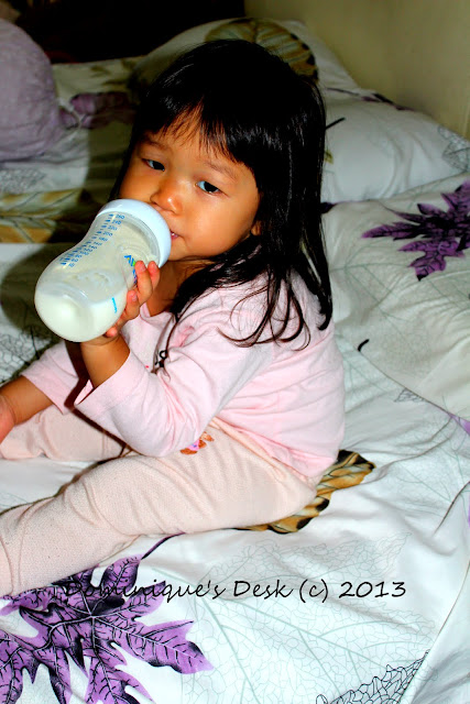 Holding the bottle with one hand