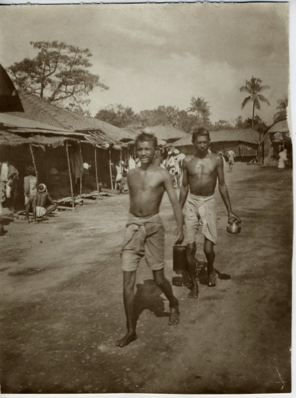 Indian Men Walking Through Village - 1900's