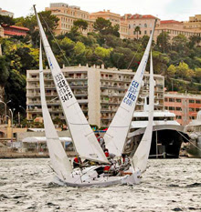 J/24s sailing upwind towards Monte Carlo, Monaco harbour