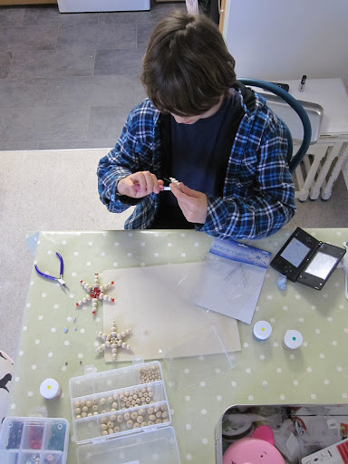 The Boy making Chirstmas snowflakes