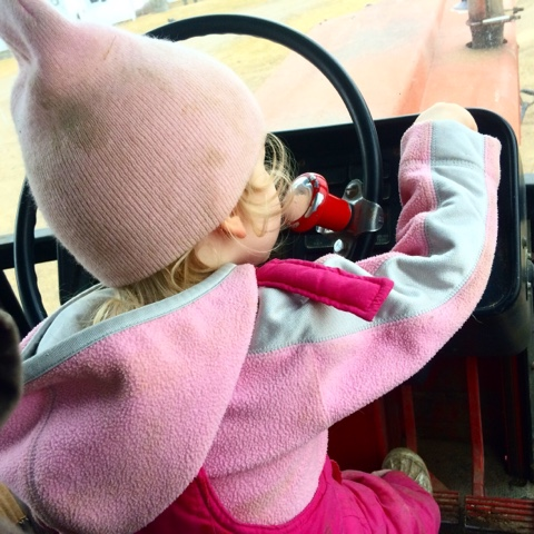 farm girl trying to drive tractor