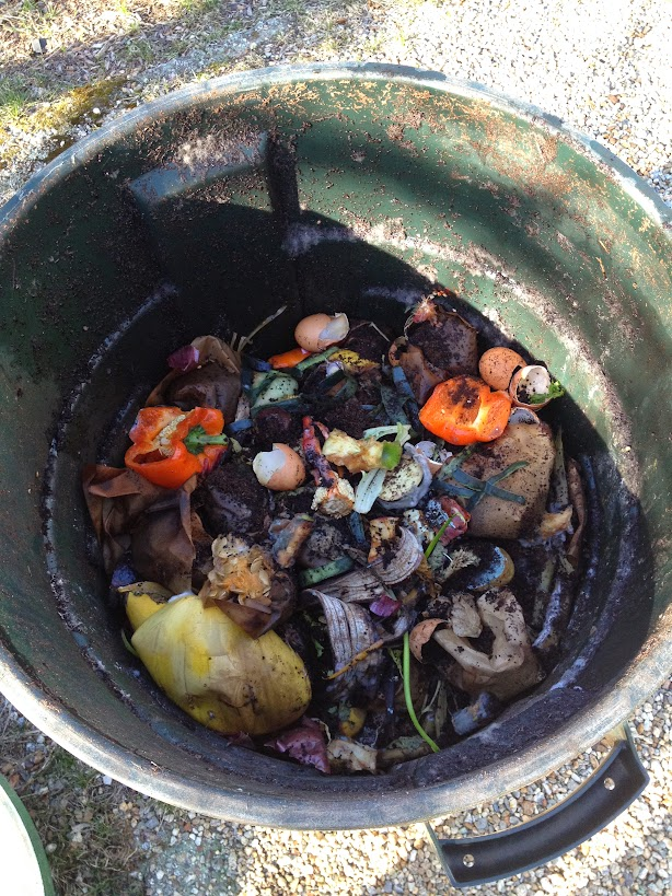 Trash barrel compost bin inside food