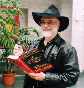 Terry Pratchett is signing his book