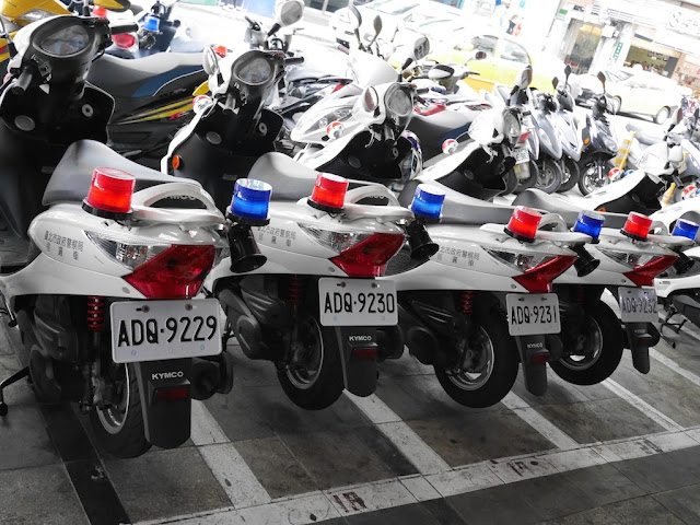 police motorbikes with ascending license plate numbers parked in a row