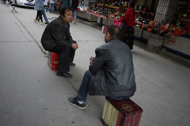 two men having a conversation in Xining, Qinghai, China