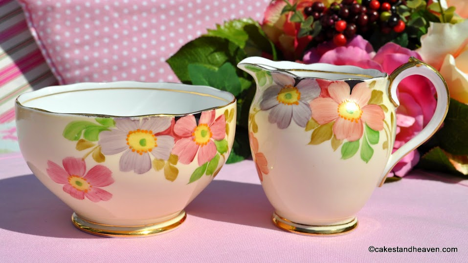 Roslyn China hand painted cream jug and sugar bowl