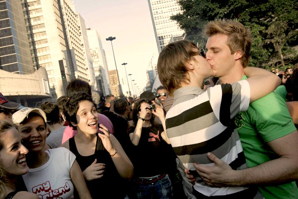 Sao Paulo, BRAZIL: A couple of revellers kisses each other at the Paulista Avenue during the Gay Pride Parade, in Sao Paulo, Brazil, 10 June 2007. More than 2,5 million people are expected to take part in the event. AFP PHOTO/Mauricio LIMA (Photo credit should read MAURICIO LIMA/AFP/Getty Images)