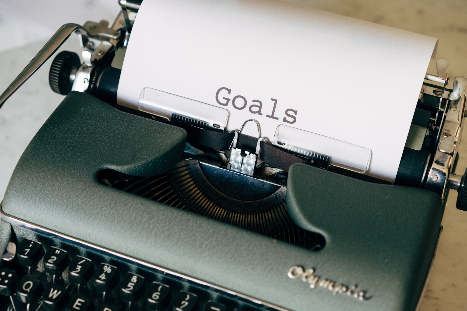 Type writer showing the word- goals