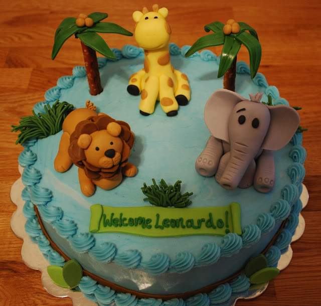 snacky french jungle themed baby shower cake