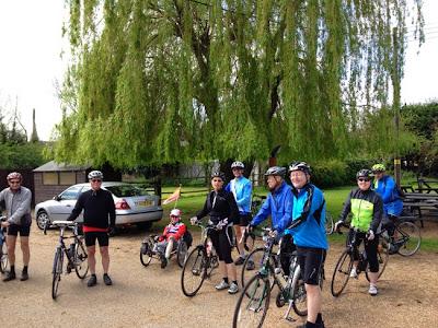 group holding bikes in pub garden