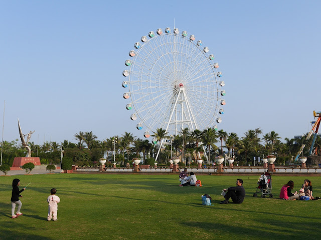 park with large ferris wheel in Zhanjiang, China