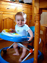 Matimu enjoying hanging out in his walker! He was only just starting to get the hang of zipping around in it before he had his accident!