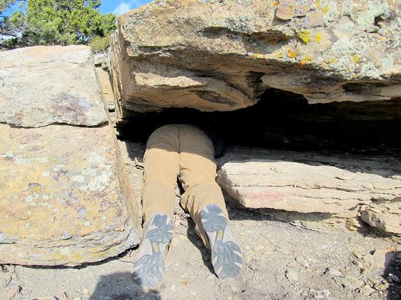 Me crawling under a ledge to retrieve a geocache