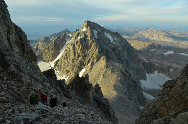 The team heads down after reaching the summit past spots of ice and snow
