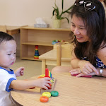 Toddlers begin to refine their focus, coordination and concentration through use of quality wooden materials that entice them.