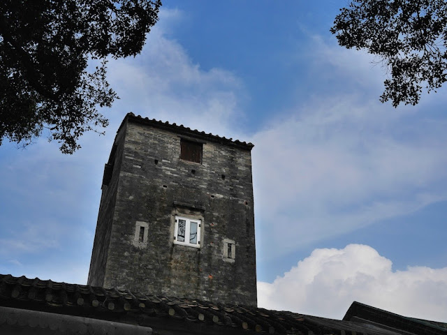 watch tower and blue sky in Shimen Village, Shaxi Town, Zhongshan