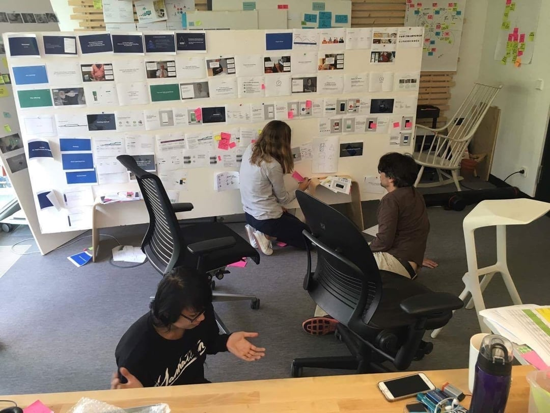 Tammy Le working with a team in a design studio setting.