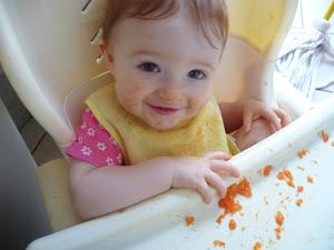 Karina eating papaya in her high chair