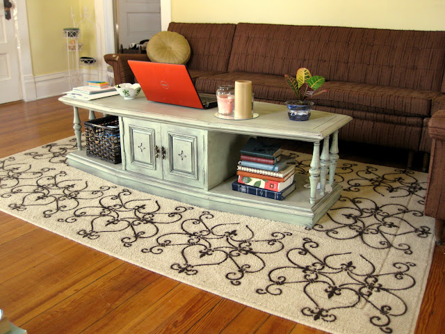 With the coffee table in the center of the rug, the newly finished DIY stencil patterns looks amazing and matching the design of the room!