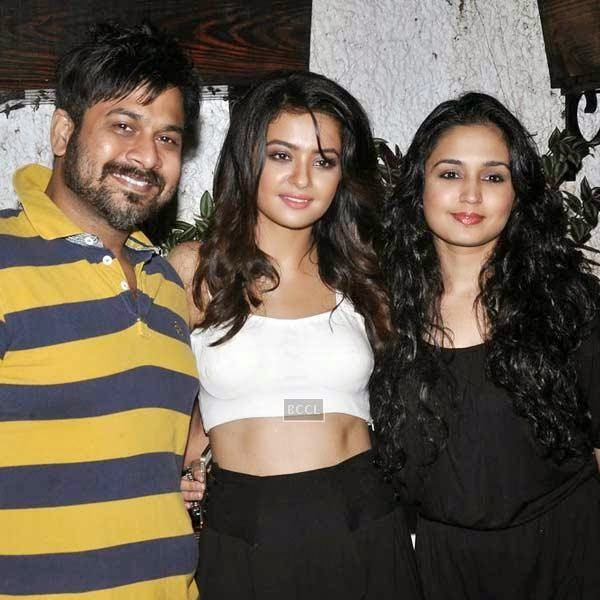 Surveen Chawla poses with her friends during the premiere of Bollywood movie Hate Story 2, held at Super Sunny Sound in Mumbai, on July 17, 2014.(Pic: Viral Bhayani)