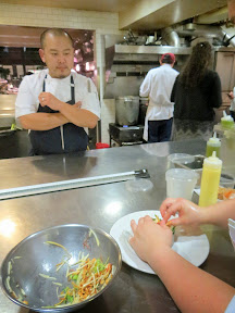 Chef Kyo Koo supervises the final plating of the salad at Blue Hour Portland