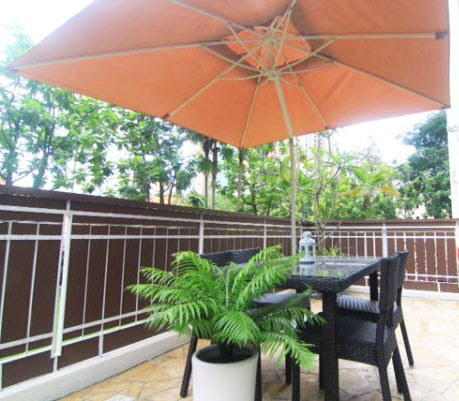 outdoor table with umbrella and chairs