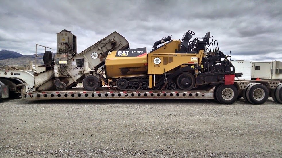 large CAT paver loaded on flatbed trailer