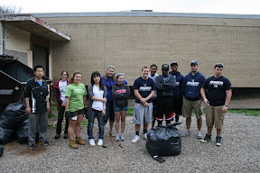 OSM/VISTA Kim Steese (second from left) with Marietta College students after a trash cleanup for Community Service Day.