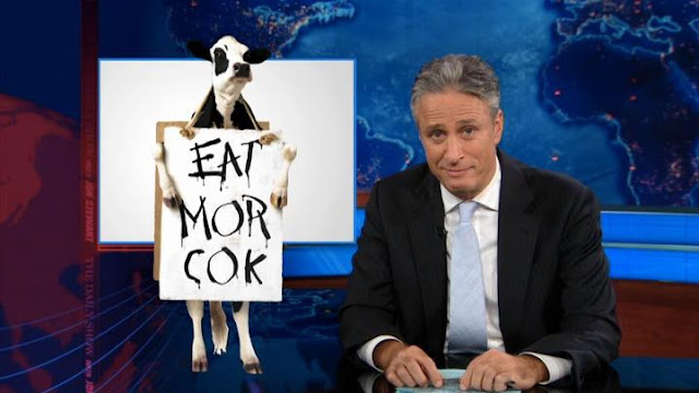 Jon Stewart and Chick-fil-A cow EAT MOR COK