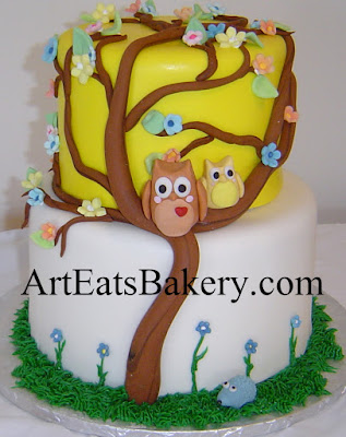 Two tier yellow and white fondant unique custom baby shower cake with 3D owls, flowers and porcupine