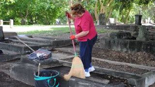 For the second time in two months the community pitches in to clean up a cemetery damaged by the 2011 floods.