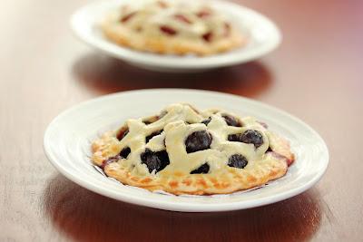 photo of a mini blueberry lattice pie