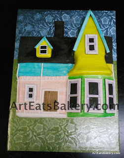 Unique creative blue, yellow, green and pink fondant Up  movie house cake with wallpapering design background