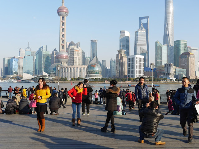 people taking photographs at the Bund in Shanghai on New Year's day