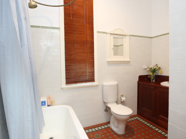Original federation tiled bathroom floor and handbasin cabinet and the loo finally gets installed in the bathroom.