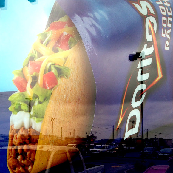 Doritos Cool Ranch poster in the window of a Taco Bell